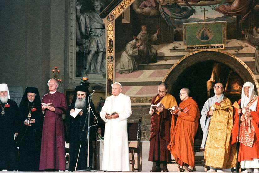 Pope John Paul II attends an inter-religious peace meeting in Assisi, Italy, in this Oct. 27, 1986, file photo. Religious leaders are celebrating the event's 30th annivesary Sept. 18-20