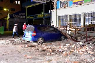 Rescue personnel enter a damaged building June 14 after a magnitude-6.9 earthquake in Quetzaltenango, Guatemala. The earthquake, near the border with Mexico, caused moderate damage to homes, triggered some landslides across highways and injured at least one person, officials said.