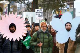 Climate change activists protest during the World Economic Forum annual meeting in Davos, Switzerland, Jan. 21.