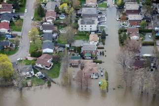 An overhead view taken May 8 shows the flooded residential neighborhood in Ile Bizard, Quebec. A mix of heavy rains and melting snow caused the situation.