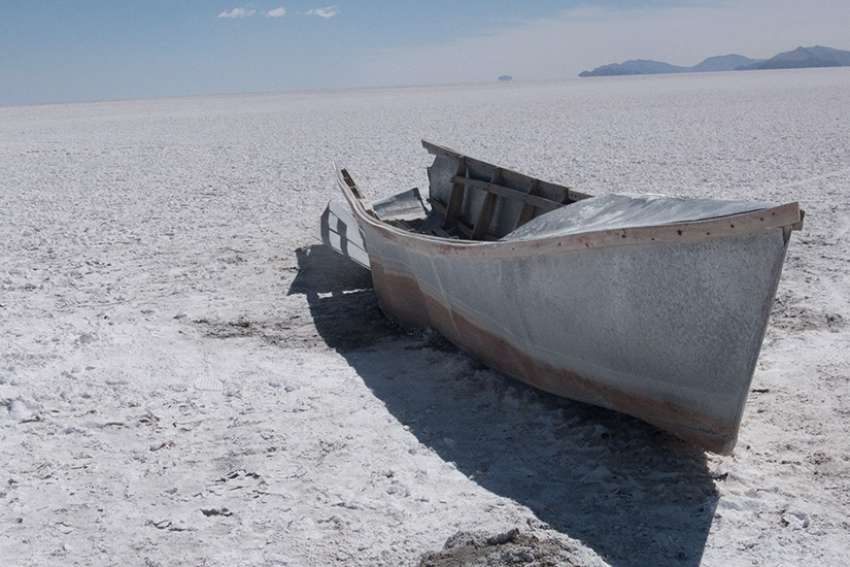 An abandoned boat lies several hundred feet from the shore of Lake Poopo in Llapallapani, Bolivia. The lake dried up three years ago and 30 million fish died almost overnight.