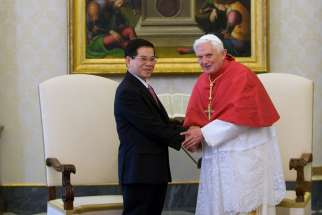 In a 2009 file photo, Vietnamese President Nguyen Minh Triet and Pope Benedict XVI are pictured during a private meeting at the Vatican. Delegations from the Vatican and from Vietnam reported continued progress in discussions between their two countries, a Vatican press statement said.