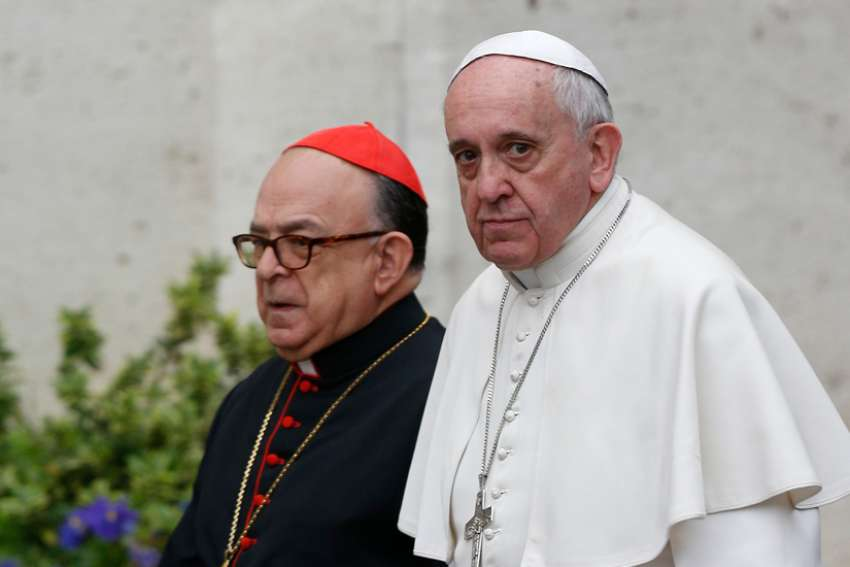 Pope Francis and Cardinal Raymundo Damasceno Assis of Aparecida, Brazil, walk to a meeting of cardinals in the synod hall at the Vatican Feb. 20, 2014. In a statement released by the Vatican Sept. 28, 2019, the pope named Cardinal Damasceno as pontifical commissioner of the Heralds of the Gospel and its religious branches for consecrated men and women.