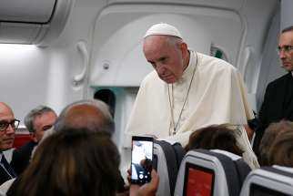 Pope Francis listens to a question from a journalist aboard his flight from Panama City to Rome, Jan. 27, 2019.
