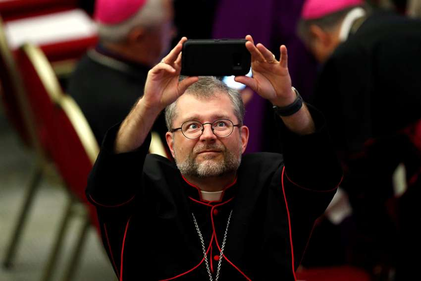 Montreal auxiliary Bishop Thomas Dowd takes a selfie before Pope Francis' audience with young people and members of the Synod of Bishops at the Vatican Oct. 6.