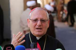 Chaldean Catholic Patriarch Louis Sako speaks to the media Aug. 9, 2014. The patriarch said Aug. 27 that it's about time Muslims and non-Muslims unite to end the spread of the Islamic State.
