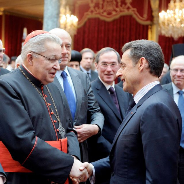 French President Nicolas Sarkozy greets Paris Cardinal Andre Vingt-Trois, next to Franc's Chief Rabbi Gilles Bernheim, left, at the Elysee Palace after he delivered his New Year wishes to the religious world.