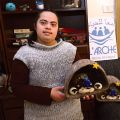 Ayat Sand, 21, a Palestinian with an intellectual disability, holds a Nativity set made from felted wool from Bethlehem sheep at the Ma'an lil-Hayat in Bethlehem, West Bank.