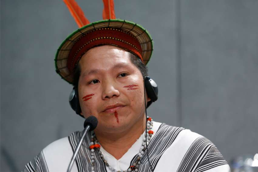 Delio Siticonatzi Camaiteri, a member of the Ashaninca indigenous people in Peru, attends a news conference after a session of the Synod of Bishops for the Amazon at the Vatican Oct. 24, 2019.
