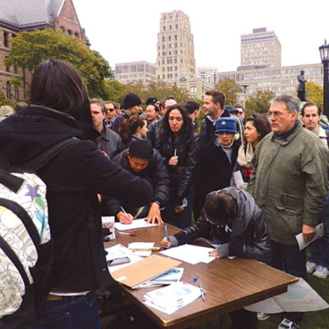 People line up to sign a defund abortion petition at the 2011 Defund Abortion Rally at Queen's Park.