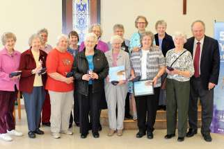 Sister Marie Zarowny, fourth from the right in the back row, and some of the Sisters of St. Ann with Serge Langlois of Development and Peace, far right.