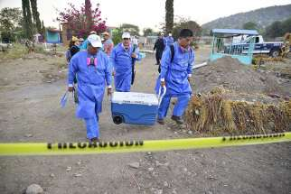 Specialists in Jojutla, Mexico, unearth remains found in unmarked graves March 21.