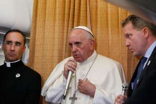 Pope Francis answers questions from journalists aboard his flight from Baku, Azerbaijan, to Rome Oct. 2. The Pope said that gay and transgender people deserve the same attentive pastoral care as anyone else.