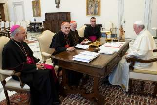 Pope Francis meets with officials representing the U.S. Conference of Catholic Bishops at the Vatican Sept. 13. Pictured from left are Archbishop Jose H. Gomez of Los Angeles, vice president of the conference, Cardinal Daniel N. DiNardo of Galveston-Houston, president of conference, Cardinal Sean P. O'Malley of Boston, president of the Pontifical Commission for the Protection of Minors, and Msgr. J. Brian Bransfield, general secretary of the conference.