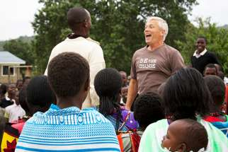 Greg Rogers welcomed by a Masai community in Kenya during a mission in 2014.