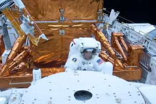 Astronaut Mike Massmino services the Hubble Space Telescope in the cargo bay of the space shuttle Atlantis May 15, 2009.