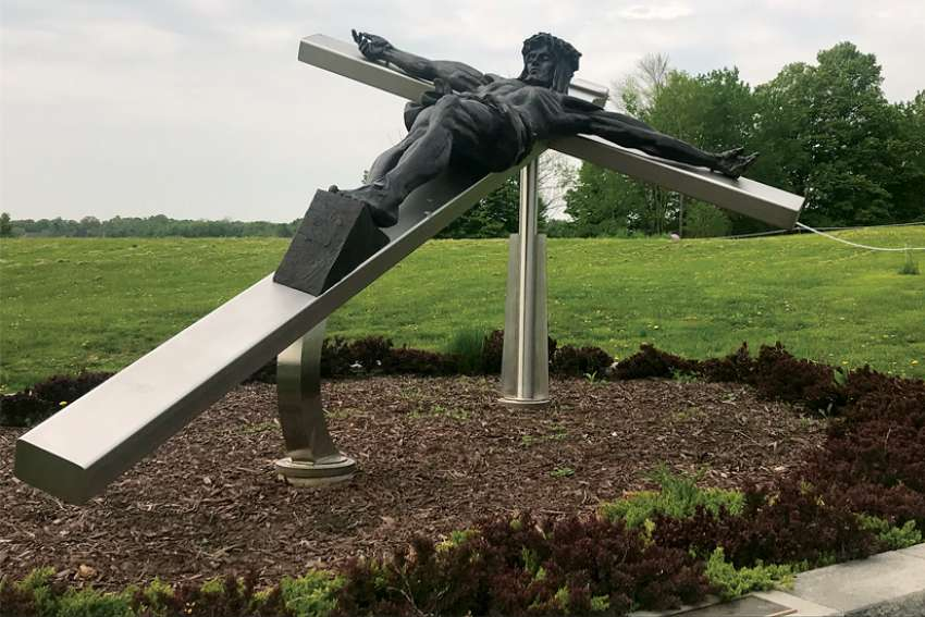A string of pods extending from a statue of Jesus marks the start of the Rosary Path at Marylake.
