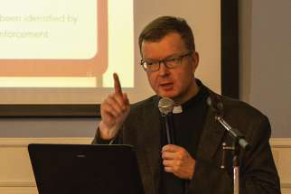 Fr. Hans Zollner addresses a symposium at Regis College March 28 on the scope of problems with children and online porn.