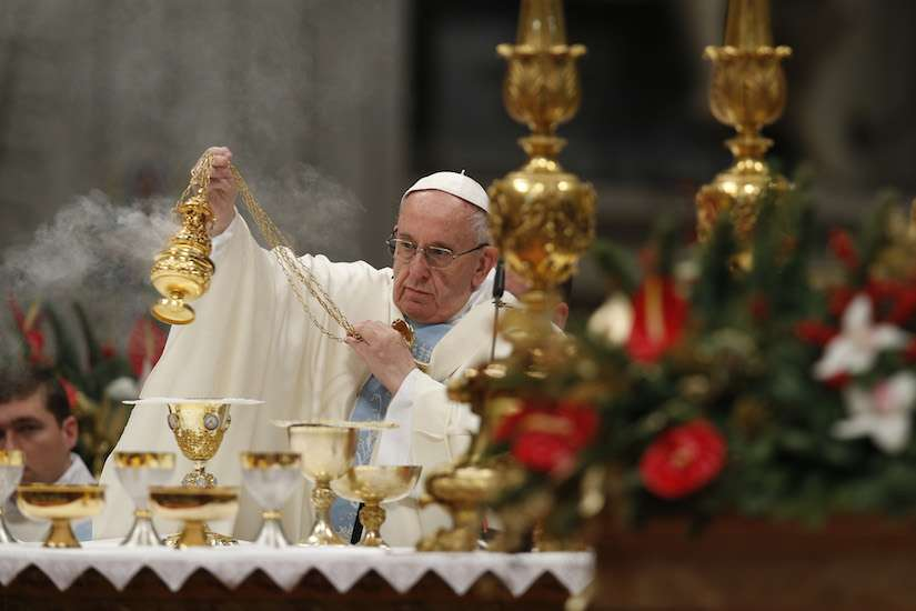 Pope Francis uses incense as he celebrates Mass marking the feast of Mary, Mother of God, in St. Peter's Basilica at the Vatican Jan. 1.
