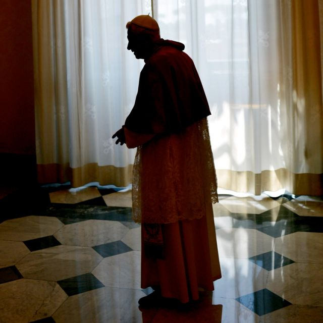 Pope Benedict XVI is seen silhouetted following a meeting with Montenegro's President Filip Vujanovic at the Vatican June 21.