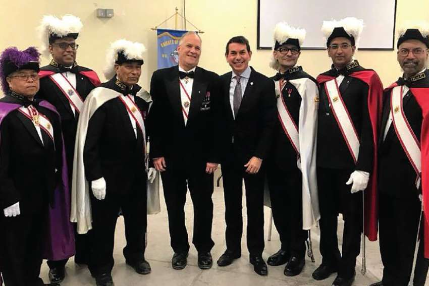 MP Peter Fonseca, fourth from right, with a Knights of Columbus honour guard at the Mass for the relic of St. Francis Xavier at the Mississauga parish named after the saint.
