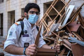 A member of the Maronite Scouts is pictured in an undated photo helping cleanup following the Aug. 4 blast in Beirut's port area.