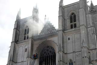 French firefighters battle a blaze at the Cathedral of Sts. Peter and Paul in Nantes July 18, 2020. Police are investigating the incident as arson because the fire started in three different places.