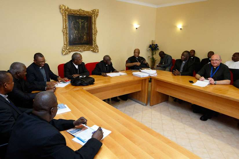 African cardinals and bishops participating in the Synod of Bishops on the family gather for a meeting in Rome Oct. 7.