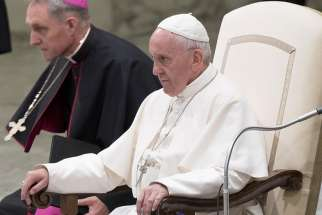 Pope Francis leads an audience with Huntington's disease patients at the Vatican May 18.