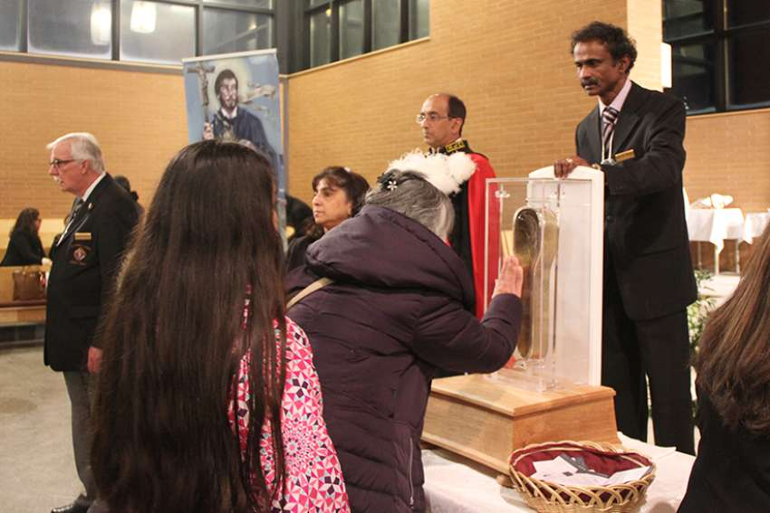 Young and old venerate the arm relic of St. Francis of Xavier in Mississauga on Jan. 13.
