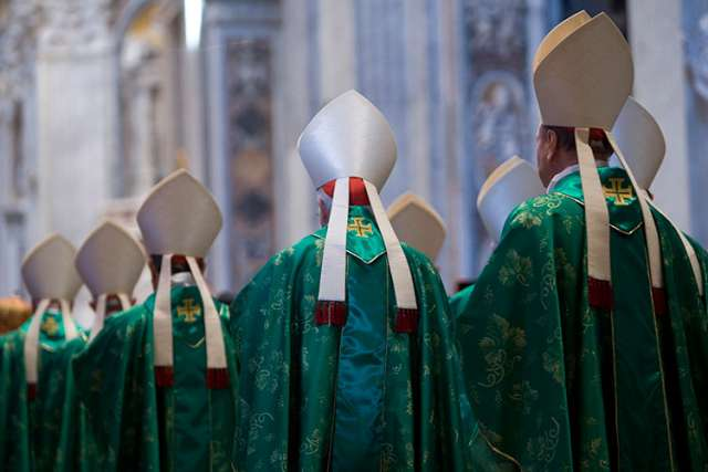 Bishops arrive in procession for a Mass celebrated by Pope Francis to open the extraordinary Synod of Bishops on the family in St. Peter's Basilica at the Vatican Oct. 5.