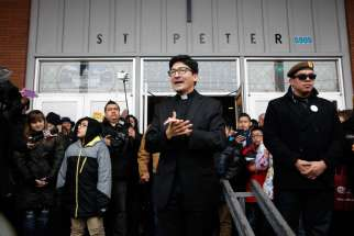 Father Raul Marquez of St. Peter Parish in Portland, Oregon, thanks people who came to stand vigil outside his church Feb. 5. The crowd formed a human shield a week after a group of eight men stood outside the front door of the church during a Spanish Mass and yelled insults about Catholicism, immigrants and the morals of the parish women.