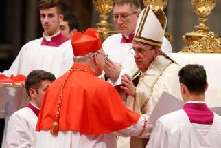 Pope Francis greets new Cardinal Kevin J. Farrell, prefect of the new Vatican office for laity, family and life, during a consistory in St. Peter's Basilica at the Vatican Nov. 19. The pope created 17 new cardinals