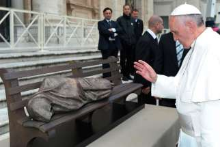 "Pope Francis blesses the sculpture ""Jesus the Homeless"" during his general audience in St. Peter's Square at the Vatican Nov. 20, 2013."