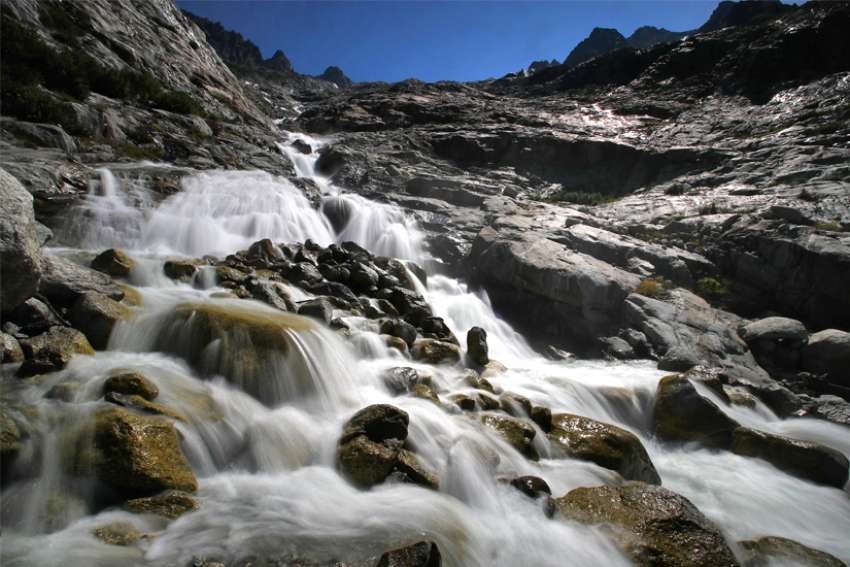 Water flows down the Trient Glacier in Trient, Switzerland, Aug. 26, 2019.