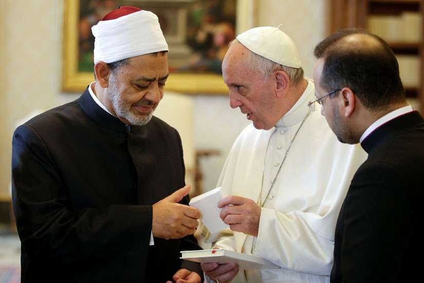 Pope Francis exchanges gifts with Ahmad el-Tayeb, grand imam of Egypt's al-Azhar mosque and university, during a private meeting at the Vatican May 23.