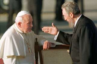 Cuban President Fidel Castro gestures to Pope John Paul II in Havana in 1998. It was the first visit to Cuba by a pope, and the Polish pontiff used it to appeal for greater religious rights.