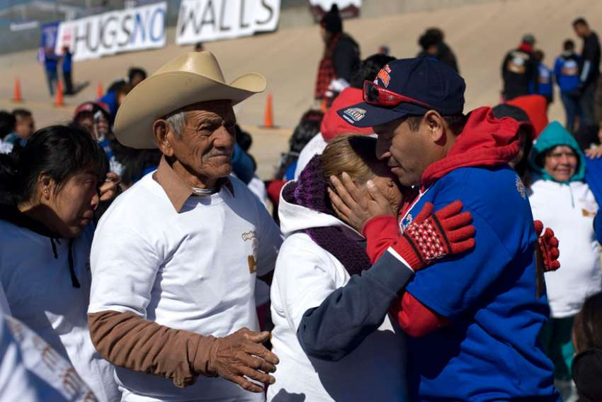 Family members embrace in El Paso, Texas, during a massive reunion Jan. 28. Mexico's Archbishop Carlos Garfias Merlos says the country needs to ask migrants for forgiveness for the failure to provide opportunities at home.