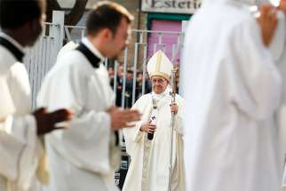 Pope Francis walks in procession as he arrives to celebrate Mass at Blessed Sacrament Parish in Rome May 6.