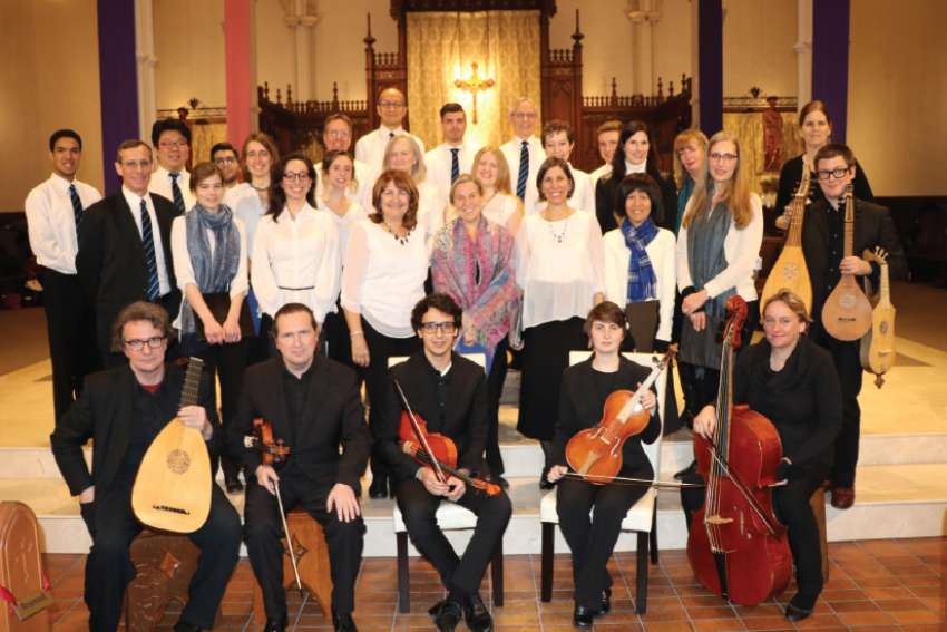 Musicians in Ordinary and the St. Michael's College Schola Cantorum, led by Michael O'Connor, second row left, bring musical meditation to the crucifixion of Christ.