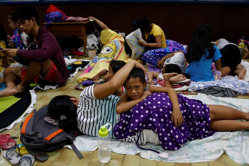 Residents of La Union, Philippines, take shelter at an evacuation center in San Fernando Oct. 19. Heavy damage was reported to homes and farmland in the northern Philippines Oct. 20 after the strongest storm in three years struck overnight.