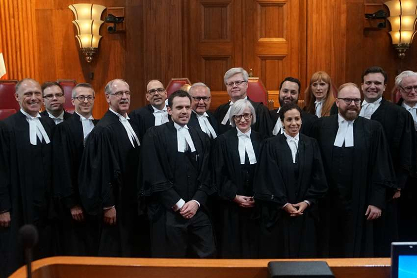 Trinity Western lawyers and interveners pose in front of the bench at the Supreme Court of Canada after the Nov. 30-Dec.1 hearings in this important religious freedom case.
