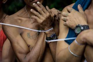Alleged drug users are arrested with zip ties during a police operation in Quezon City, Philippines, Oct. 5.