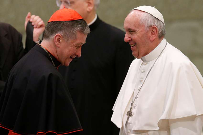 Cardinal Blase J. Cupich of Chicago walks away after meeting Pope Francis during his general audience in Paul VI hall at the Vatican Feb. 7.