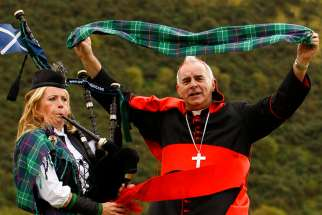 Cardinal Keith O'Brien of St. Andrews and Edinburgh, Scotland, unveils a limited edition papal visit tartan in 2010 in Edinburgh. Cardinal O'Brien, who resigned five years ago after admitting to sexual misconduct, died early March 19 at the age of 80.