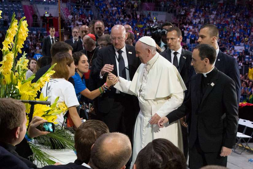 Pope Francis thanks World Youth Day volunteers gathered at the Tauron Arena July 31 in Krakow, Poland.