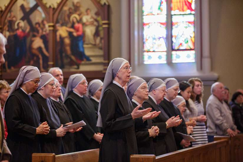 Members of the Little Sisters of the Poor pray during Mass at the Basilica of the Sacred Heart at the University of Notre Dame in Indiana April 9.