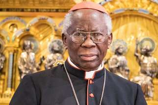 Nigerian Cardinal Francis Arinze poses May 23 in Buckfast Abbey in Buckfastleigh, England. Communion is exclusively for Catholics in a state of grace and not something to be shared between friends like beer or cake, said Cardinal Arinze.
