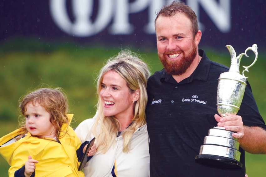 Irish golfer Shane Lowry poses with his wife, Wendy, and daughter, Iris, after winning the Open Championship July 21.