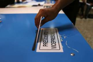 A woman casts her ballot during general elections in Guatemala City Sept. 6. Guatemalans have protested and prayed and achieved unprecedented political change in their country.